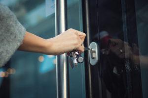 Locking door with a key.